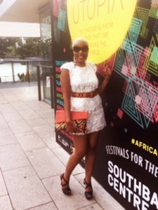 CG Couture Muse wearing Clariscia Gill Kente Cloth belt accessory.